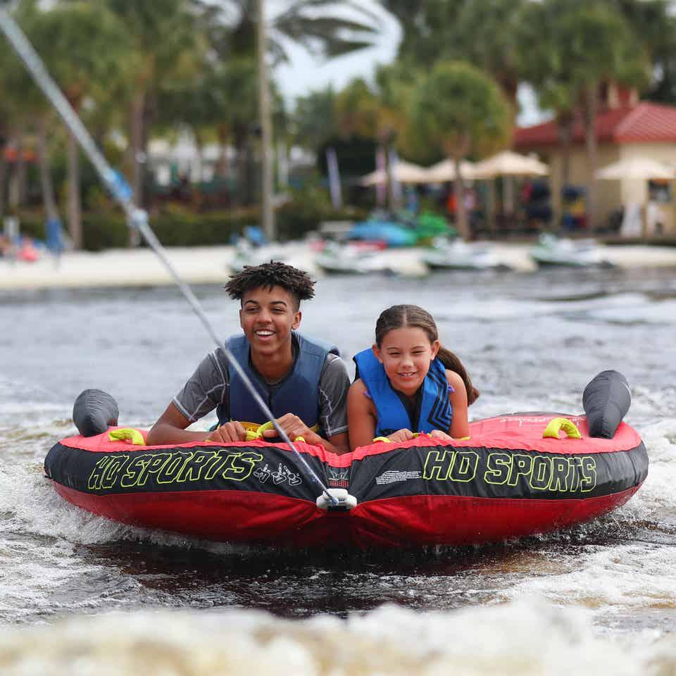 Two children tubing at Orange Lake Resort near Orlando, Florida.