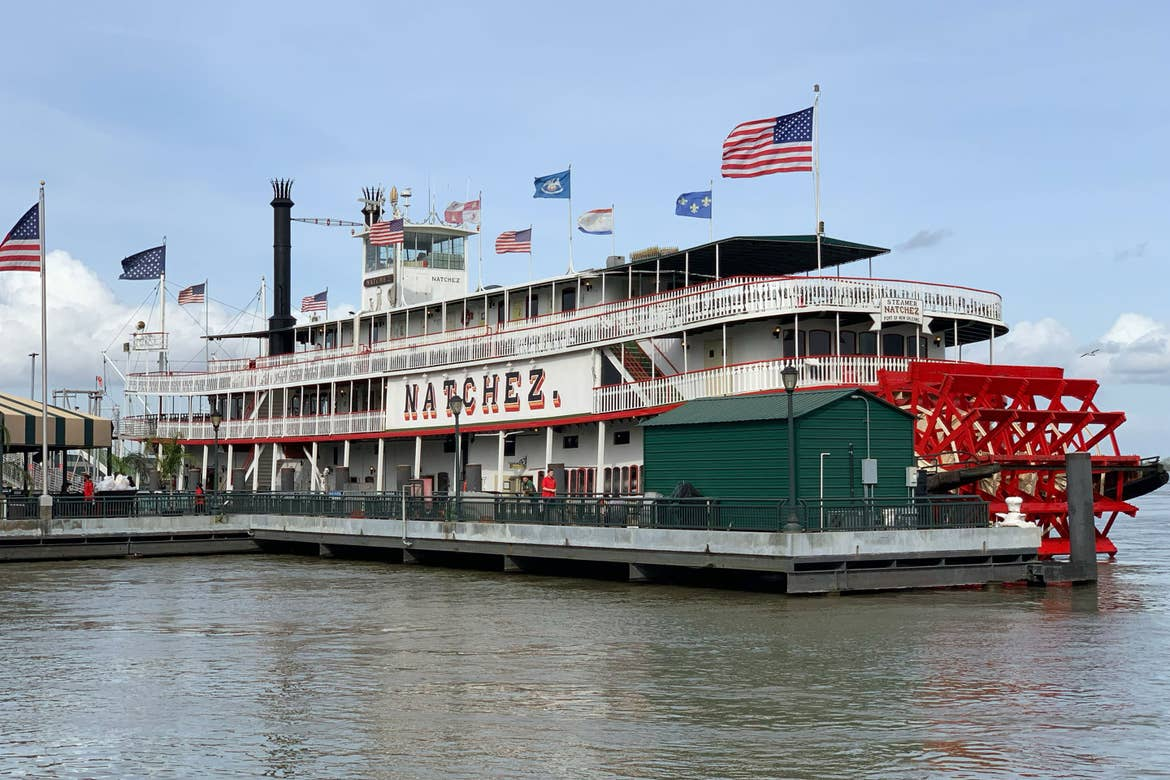 The City of New Orleans Natchez Steamboat docked on the Mississippi River.