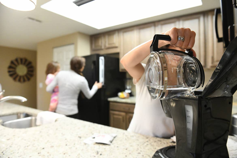 Raff's family using the kitchen in their Orange Lake Resort villa