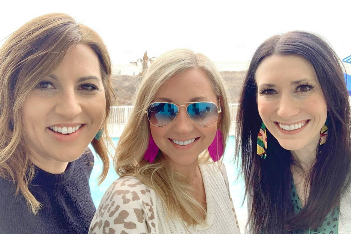 Featured Contributor, Amanda Nall (middle) poses with her two friends on the beach near our Galveston Beach Resort in Galveston, Tx.