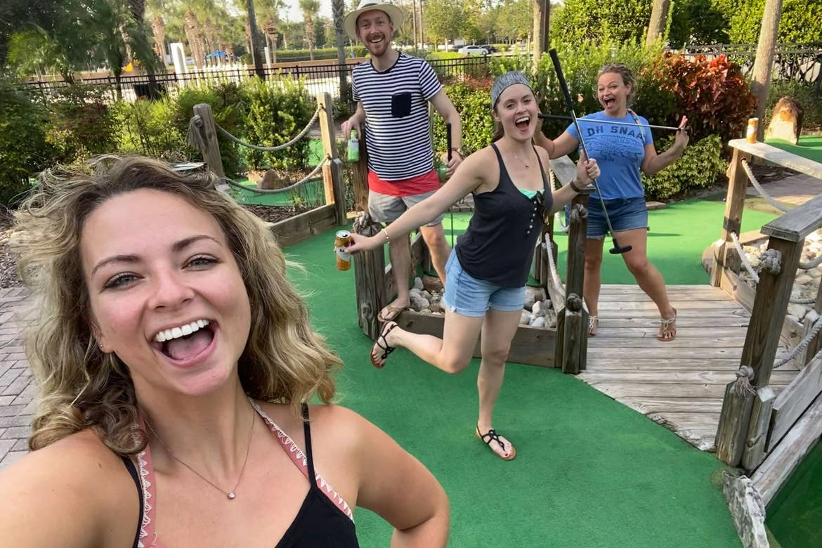 Featured Contributor, Angie Orth (left), and her sister and two friends (right) pose on the mini golf course at our Orange Lake resort in Orlando, Florida.