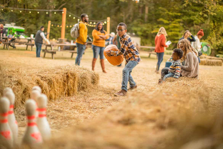 Tina's son playing pumpkin boo-ling, or bowling, at Falladays at Villages Resort