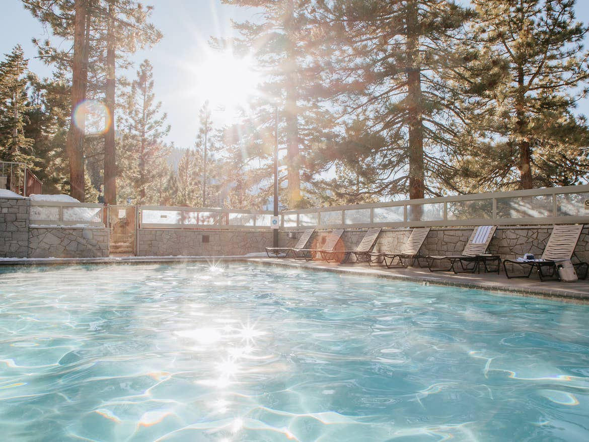 Outdoor pool surrounded by trees at Tahoe Ridge Resort in Stateline, Nevada.