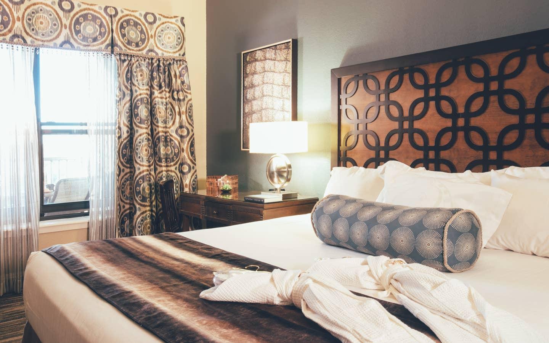 Bedroom with large window in a Signature villa in River Island at Orange Lake Resort near Orlando, Florida