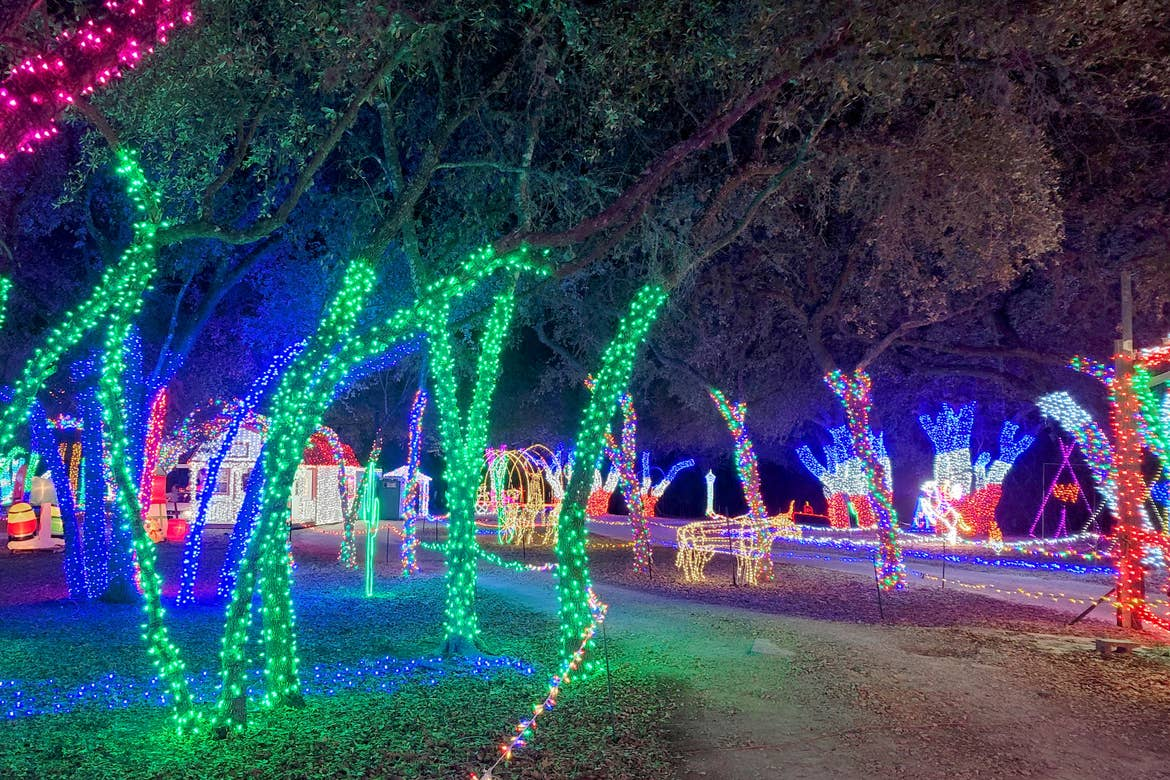 'Sights & Sounds of Christmas' decorations of green string lights wrapped around trees and light-animals.