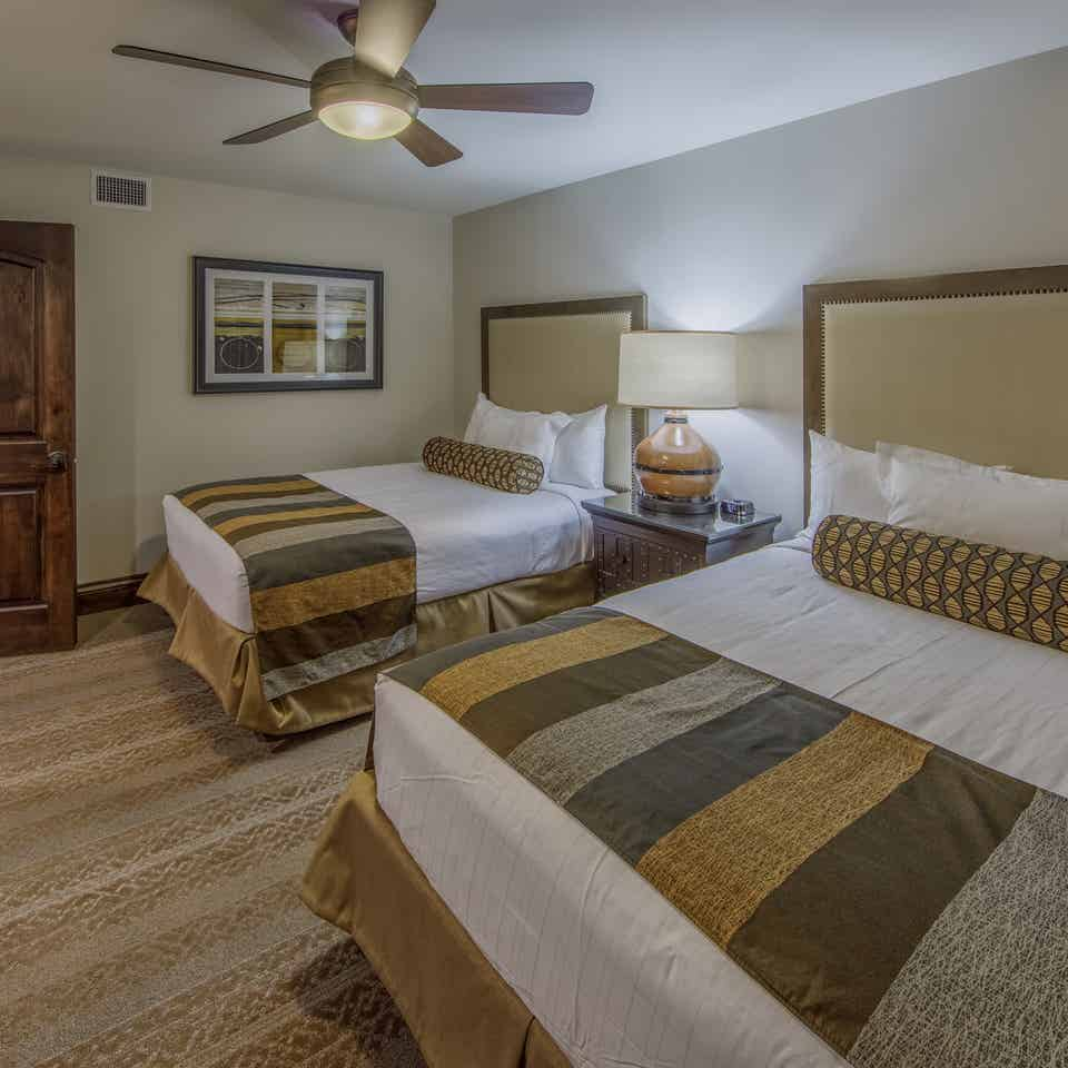 Bedroom with two double beds in the Three-Bedroom Signature Villa at the Scottsdale Resort in Arizona