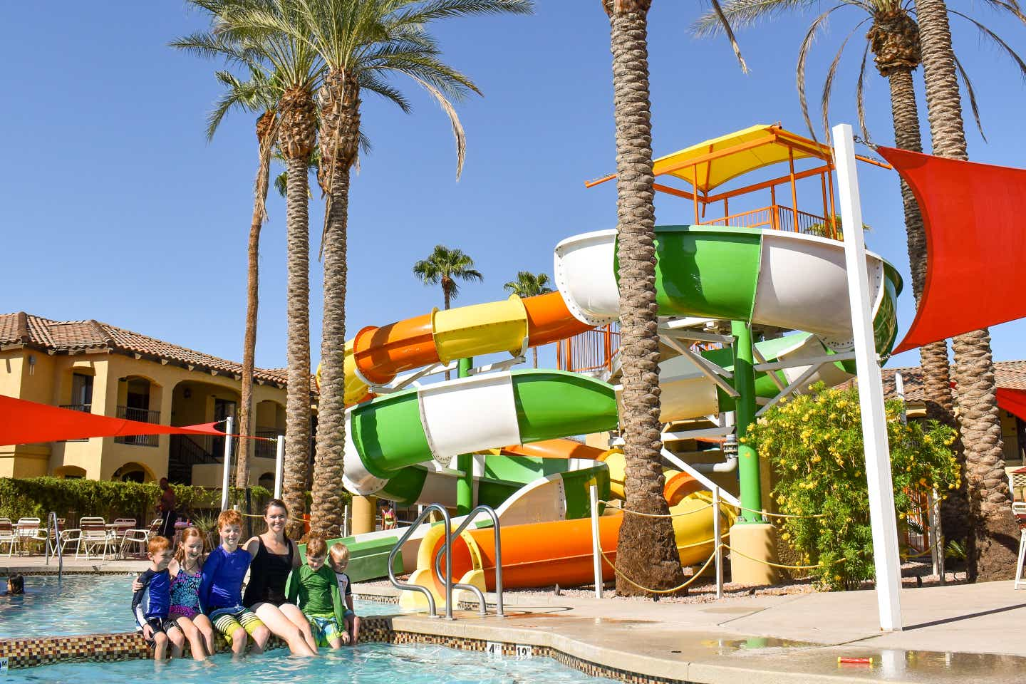 Author, Jessica Averett, and her family sit poolside at our Scottsdale Resort in Arizona.