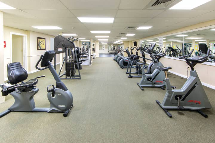 Fitness center with several machines including weights and stationary bikes at Oak n' Spruce Resort in South Lee, Massachusetts