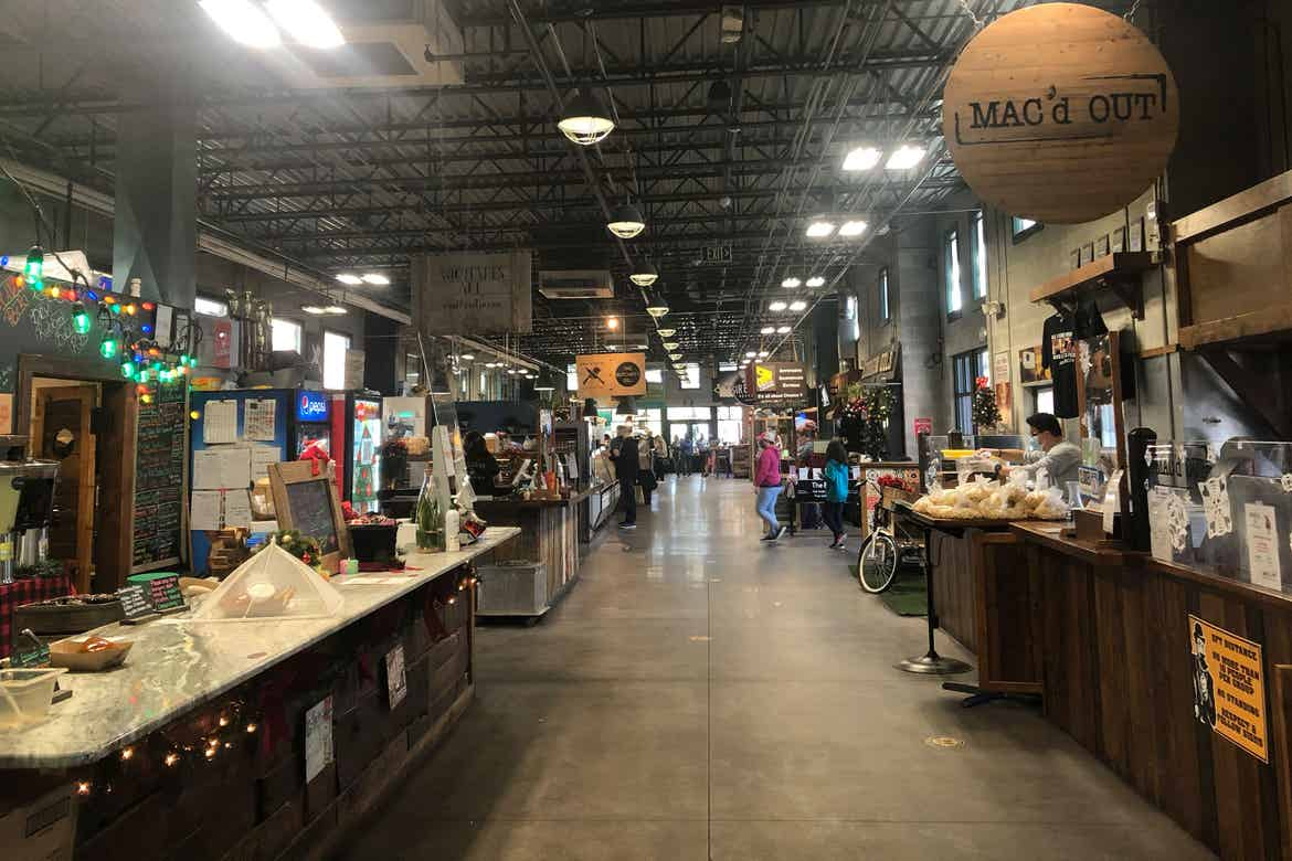 Interior of Plant Street Market with various vendors.