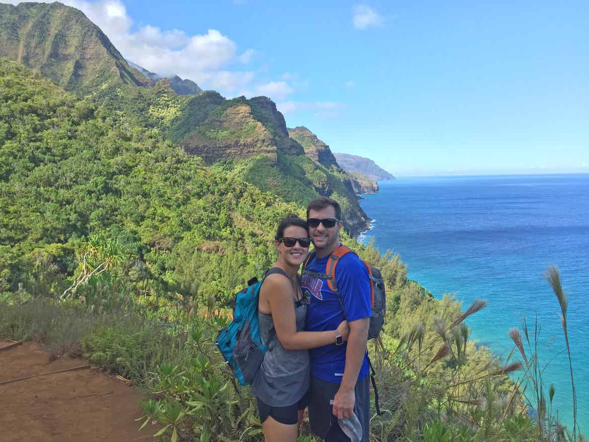 Jennifer and Anthony Harmon stand in front of the Ne-Pali in Hawaii