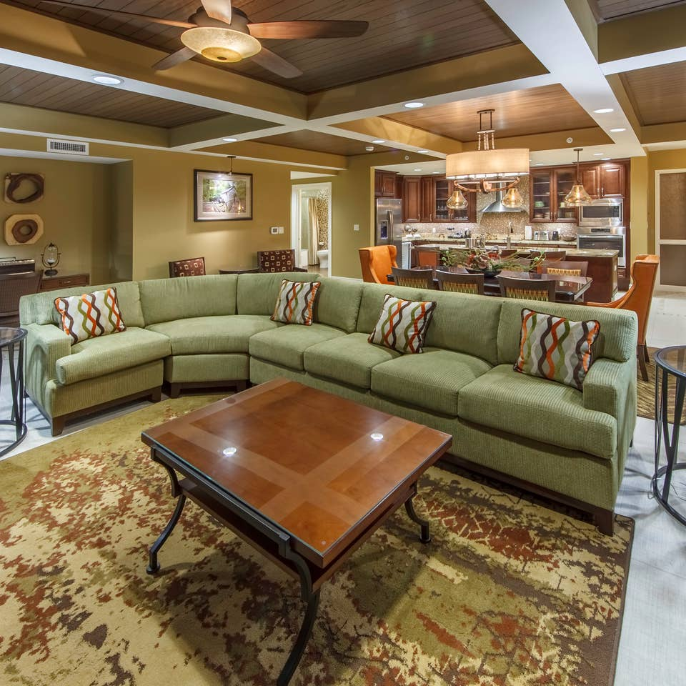 Living room with sectional couch in a Signature Collection villa at Smoky Mountain Resort in Gatlinburg, Tennessee.