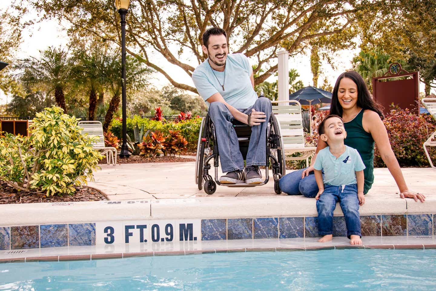 Author, Danny Pitaluga (left), his wife, Val (right) and son, Joey (middle), sit alongside the edge of our pool at our Orange Lake Resort located in Orlando, Florida.