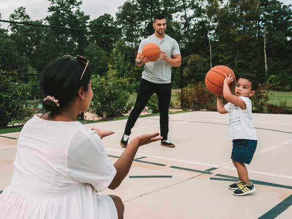 A family playing basketball on a court