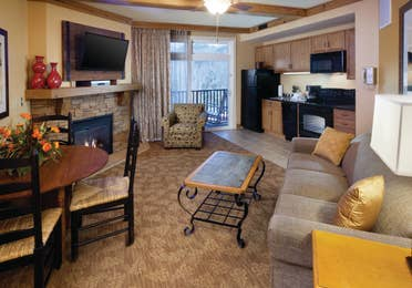 Living room and kitchen area in a villa at Smoky Mountain Resort in Gatlinburg, Tennessee.