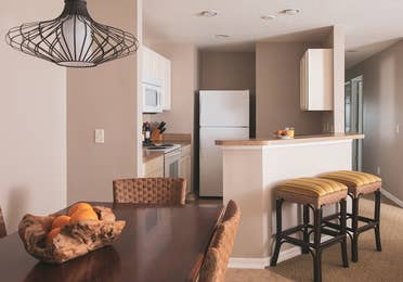 Kitchen and dining table in a three-bedroom villa at Orlando Breeze Resort.