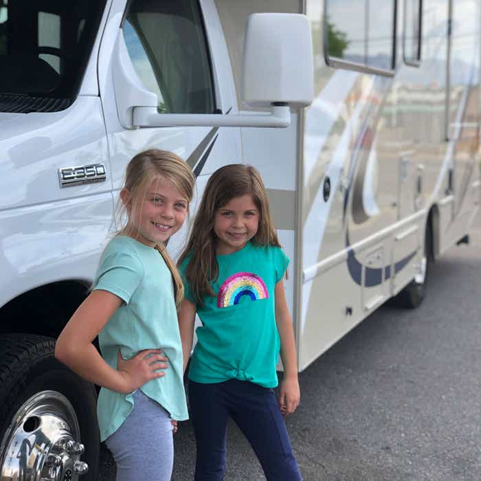 Kyndall and Kyler stand in front of the RV rental.