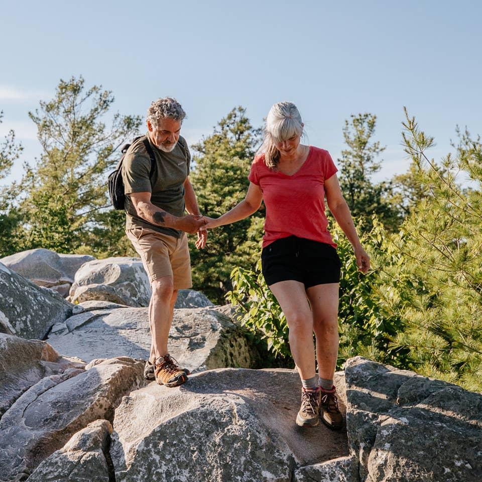 Couple hiking near Oak n' Spruce Resort in South Lee, Massachusetts.