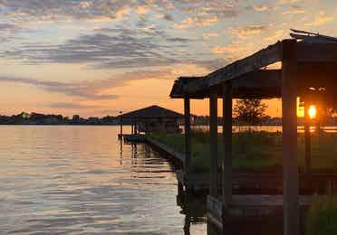 Lake Conroe dock at sunset near Piney Shores Resort in Conroe, Texas.