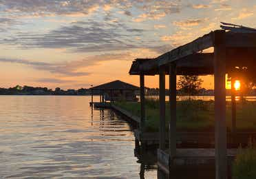 Lake Conroe dock at sunset near Piney Shores Resort in Conroe, Texas.