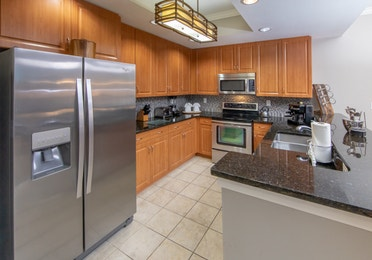Full kitchen with stainless steel appliances in a three-bedroom villa at Sunset Cove Resort in Marco Island, Florida