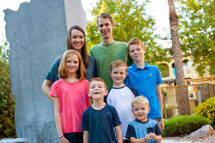 Author Jessica Averett and her family stand outside of our Scottsdale Resort.