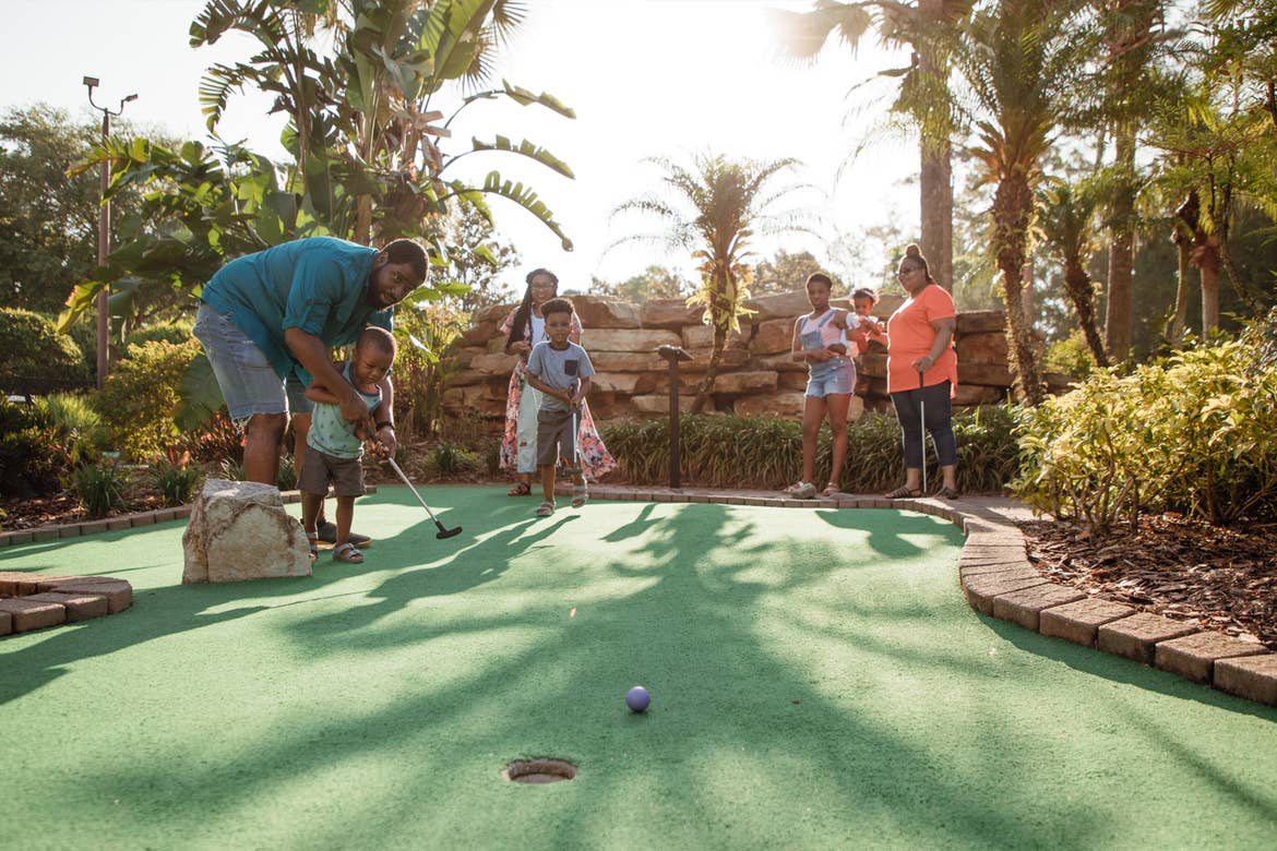 The Godfrey family of seven enjoy a round of mini golf at our Orange Lake Resort located in Orlando, FL.