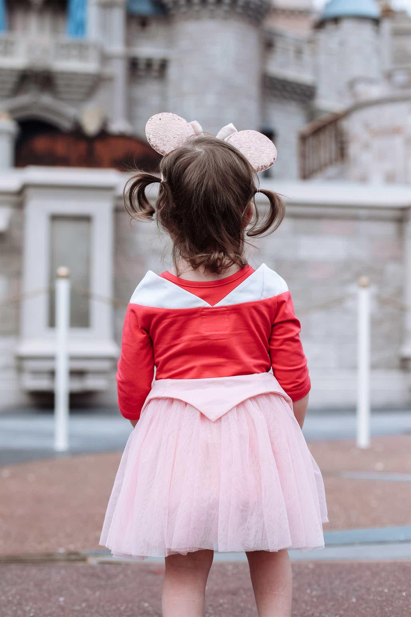 Mia's daughter looking at Cinderella Castle