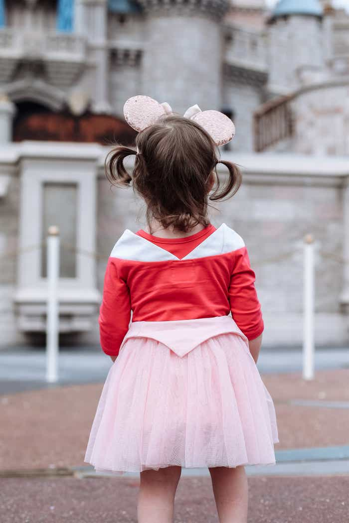 Mia's daughter looking at Cinderella Castle