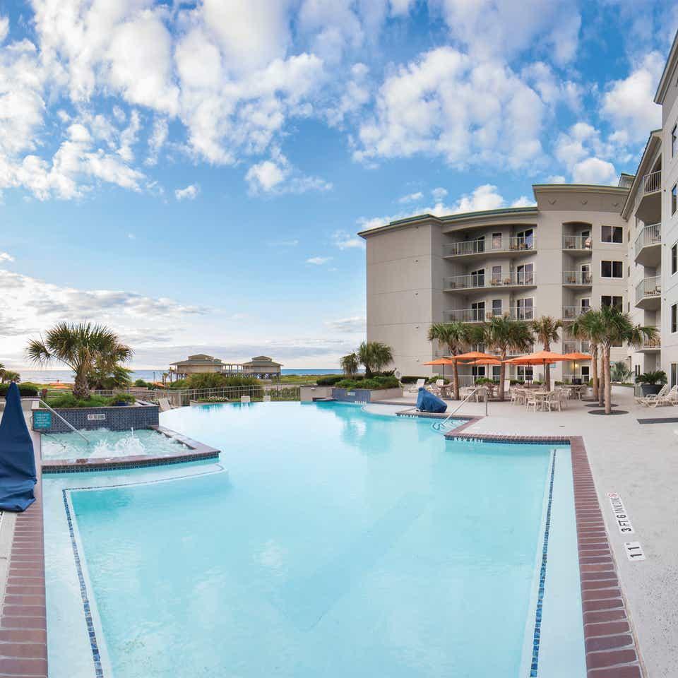Outdoor infinity pool overlooking the beach at Galveston Beach Resort in Texas.