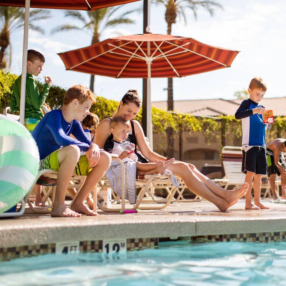 Family by the pool at Scottsdale Resort in Scottsdale, Arizona.