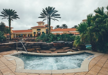 Hot tub surrounded by palm trees in River Island at Orange Lake Resort near Orlando, Florida