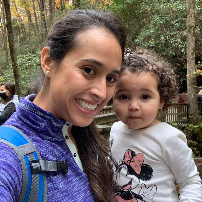 Featured author, Andrea Beltran (left), poses with her niece (right) surrounded by dropped fall foliage.