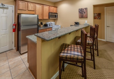 Full kitchen with refrigerator, stove, and microwave in a two-bedroom villa at David Walley's Resort in Genoa, Nevada