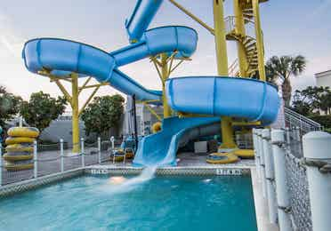 Outdoor pool with a waterslide at Cape Canaveral Resort