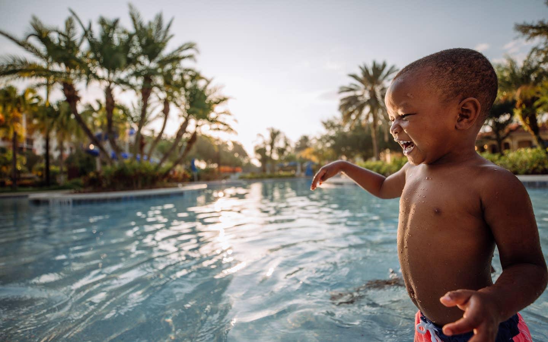 Young child playing in pool at Orange Lake Resort near Orlando, Florida.