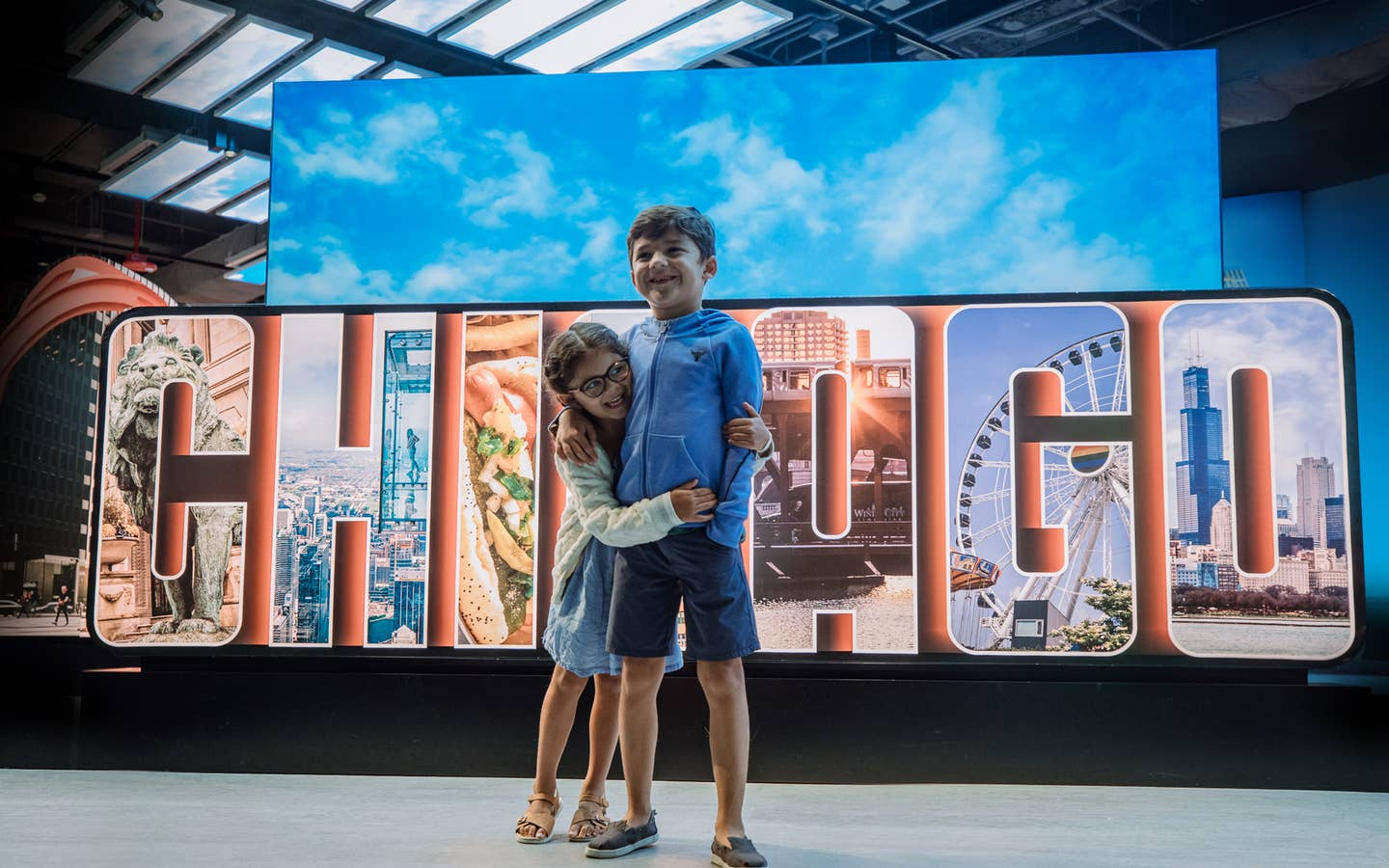 Kids hugging in front of Chicago sign at Chicago, Illinois