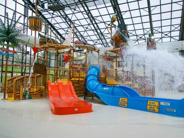 Waterslides in Pirate's Cay Indoor Waterpark at Fox River Resort in Sheridan, Illinois.