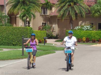 Denise and CJ riding their bikes in a residential neighborhood of Marco Island, Florida
