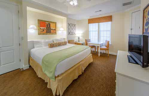 Bedroom with dining area in a two-bedroom presidential villa at Galveston Seaside Resort