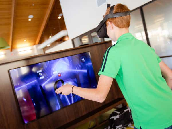 Young child playing virtual reality video game at Scottsdale Resort in Scottsdale, Arizona.
