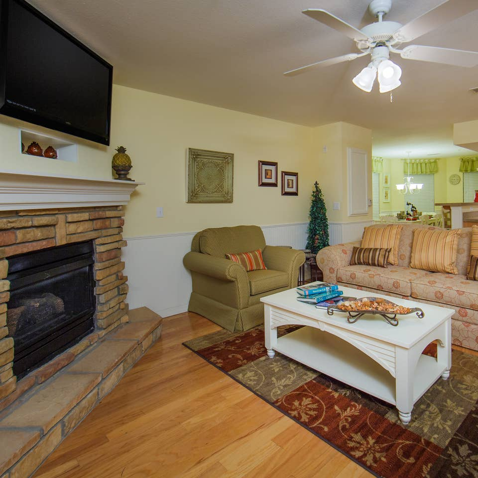 Living room with fireplace in a two-bedroom presidential villa at the Holiday Hills Resort in Branson Missouri.