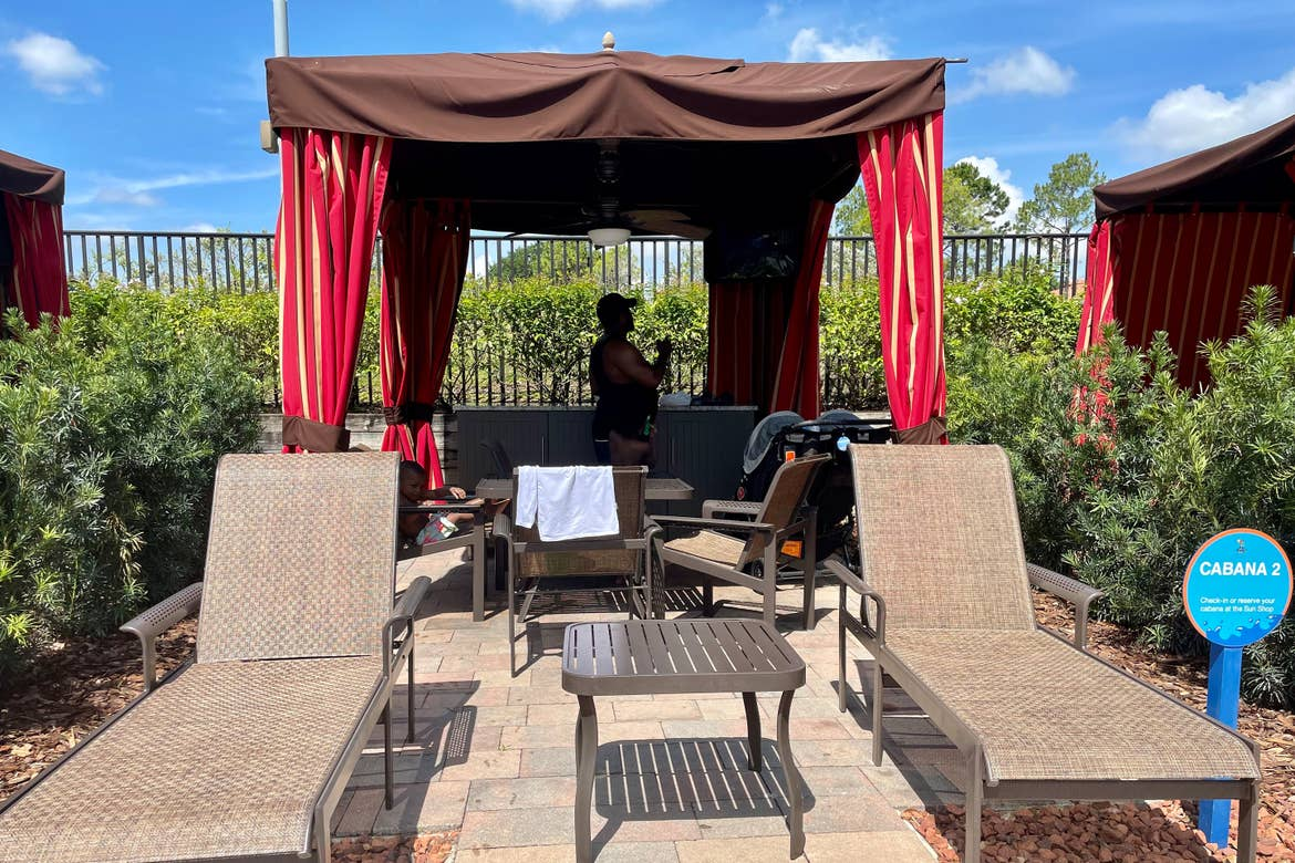 Krystin Godfrey's husband, Phillip, sets up various poolside items in the shade of our River Island cabana.