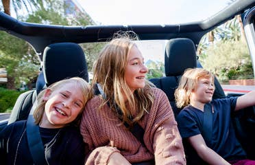 The Haby kids riding in the backseat of an open-top Jeep down the Vegas strip.