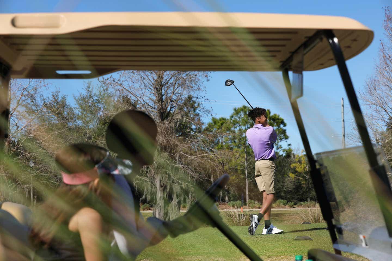 Clarissa's son golfing
