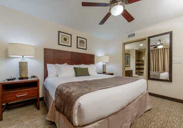 Master bedroom with king bed and attached bathroom in a three-bedroom villa at Scottsdale Resort