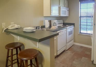 Kitchen and amenities in a two-bedroom villa at the Holiday Hills Resort in Branson Missouri.