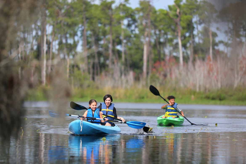 Clarissa kayaking with her kids