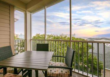 Balcony with outdoor furniture in a three-bedroom Signature Collection villa at South Beach Resort in Myrtle Beach, South Carolina.