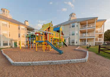 Outdoor children's playground outside of property buildings at Piney Shores Resort in Conroe, Texas