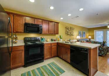 Kitchen view in a three-bedroom ambassador villa at the Holiday Hills Resort in Branson Missouri.